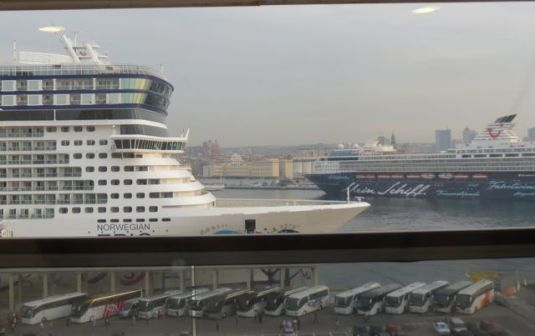 Notice the Norwegian  Epic holding 4,000+passengers and the buses waiting to take them somewhere!